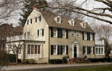 """NEW YORK - MARCH 31: Real estate photograph of a house located at 112 Ocean Avenue in the town of Amityville, New York March 31, 2005. The Amityville Horror house rich history and beauty are overshadowed by the story of George and Kathy Lutz, the previous residents of 112 Ocean Avenue, who claimed that shortly after moving into the house they fled in terror driven out by paranormal activity. The best selling novel and popular movie have marked the town as the site of the most famous haunted house in history, yet many are unaware that the true history of this house is much darker than """"The Amityville Horror's"""" icy drafts and bleeding walls. Six members of the DeFeo family were murdered at 112 Ocean Avenue one year before the Lutz family moved in and their tragedy haunts the citizens of Amityville to this day. (Photo by Paul Hawthorne/Getty Images)"""